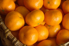 Ripe oranges in basket closeup Royalty Free Stock Images