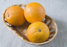 Ripe oranges in a basket Stock Image