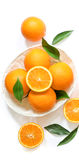 Ripe oranges in the basket isolated on white background top view. Royalty Free Stock Images