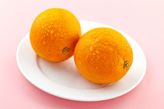 Ripe oranges with drops of water Stock Image