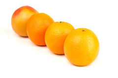 Ripe oranges and grapefruit. On a white background Stock Photo