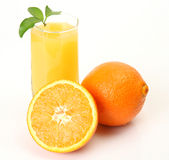 Ripe oranges and juice Stock Image
