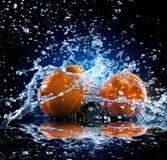 Ripe oranges on mirror Royalty Free Stock Photos