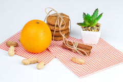 Ripe oranges, peanuts, oatmeal cookies and aloe. On a white background Stock Photo
