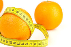 Ripe oranges and tape measure Stock Images