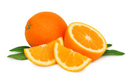 Ripe oranges and two slices with green leaves () Royalty Free Stock Images