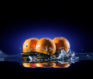 Ripe oranges in water Stock Photos