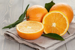 Ripe oranges on wooden table. Rustic style stock photography