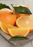 Ripe oranges on wooden table Stock Photography