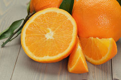 Ripe oranges on wooden table Royalty Free Stock Photography