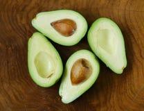 Ripe organic avocado cut in half Royalty Free Stock Images