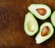 Ripe organic avocado cut in half Royalty Free Stock Image