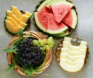 Ripe organic fruit watermelon, melon cantaloupe and grapes on a wooden table Stock Photography
