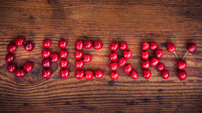 Ripe organic homegrown cherries, Cherry text stock photo