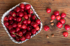 Ripe organic homegrown cherries and stones in a vintage ceramic bowl Stock Images