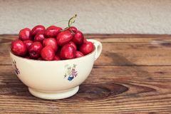 Ripe organic homegrown cherries and stones in a vintage ceramic bowl Stock Photography