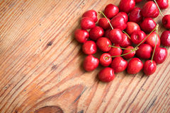 Ripe organic homegrown cherries on wooden background Stock Image