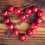 Ripe organic homegrown cherries on wooden background Royalty Free Stock Photos