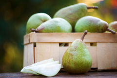 Ripe organic pears in a basket Royalty Free Stock Images