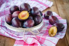 Ripe organic plums in a bowl Stock Images