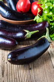 Ripe organic purple eggplant. On rustic wooden background, autumn harvest concept Stock Photography