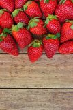 Ripe Organic Strawberries Scattered on Weathered Wood Background Healthy food Cleansing Summer Harvest. Diet Top View Copy Space Food Pattern Stock Images