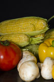 Ripe organic vegetables on wooden table at dark background Stock Photos