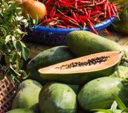 Ripe papaya and red pepper Royalty Free Stock Photo