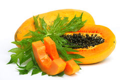 Ripe papaya with seeds and leaf Royalty Free Stock Photography