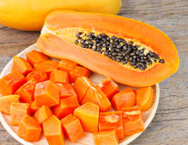 Ripe papaya on wooden table Stock Photo