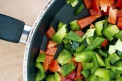 Ripe paprika on frying pan Stock Photos