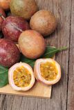Ripe passion fruit is delicious on wood background. Royalty Free Stock Images