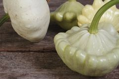 Ripe pattypan squash on a old table Stock Photos