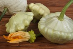 Ripe pattypan squash vegetables on a wooden Stock Image