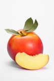 Ripe peach. On a white background Royalty Free Stock Photo
