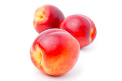Ripe peach. On a white background royalty free stock image