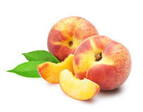 Ripe peach. Fruit with leaves and slises on white background Royalty Free Stock Images