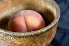 Ripe peach in bowl Royalty Free Stock Images