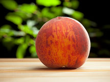 Ripe peach on the desk Royalty Free Stock Photo
