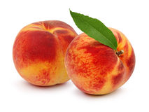 Ripe peach fruit with green leafs Royalty Free Stock Image