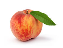 Ripe peach fruit with green leafs Royalty Free Stock Photography