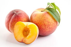 Ripe peach fruit with leaves and slises Stock Photos