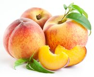 Ripe peach fruit with leaves and slises Royalty Free Stock Images