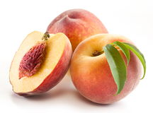 Ripe peach fruit with leaves and slises Royalty Free Stock Photos