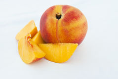 Ripe Peach fruit and slices. Isolated on white background cutout Stock Photos