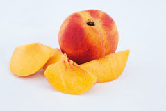 Ripe Peach fruit and slices Stock Photos