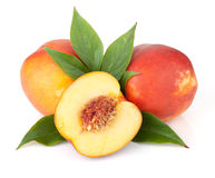 Ripe peach fruits. With green leaves. Isolated on white background stock photos