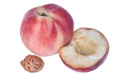 Ripe peach halves with bone isolated on white background royalty free stock photo
