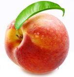 Ripe peach with a leaf. Stock Photo