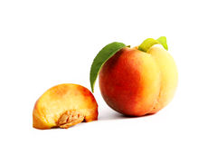 Ripe peach with a leaf on a white background Royalty Free Stock Images